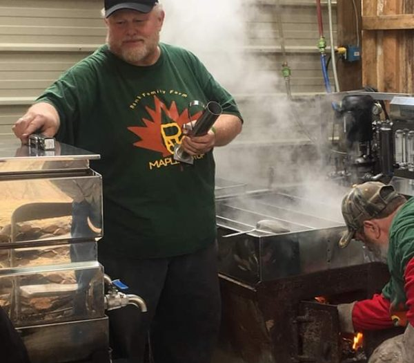 Paul Ronk in front of his evaporator. He started making maple syrup on his property after helping a friend in Ohio.